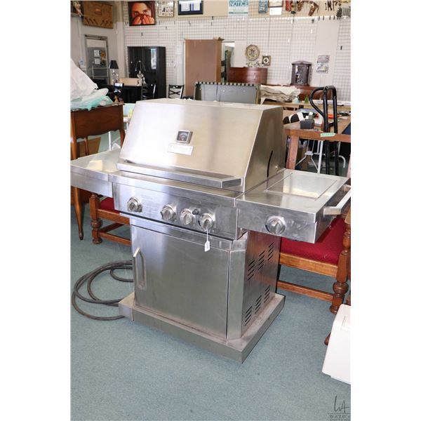 Stainless steel natural gas barbecue with side prep tray on left and burner on the right, made by St