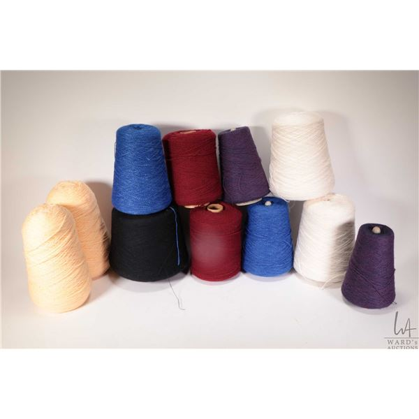 Eleven near full and partial cones of knitting machine/hand knitting yarn including two Spinright Na