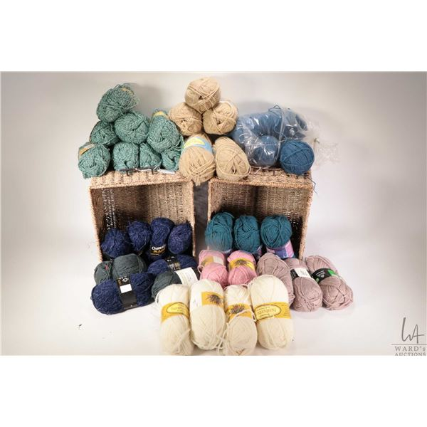 Three sea grass baskets full of hand knitting and knitting machine yarn including full cone of Glens