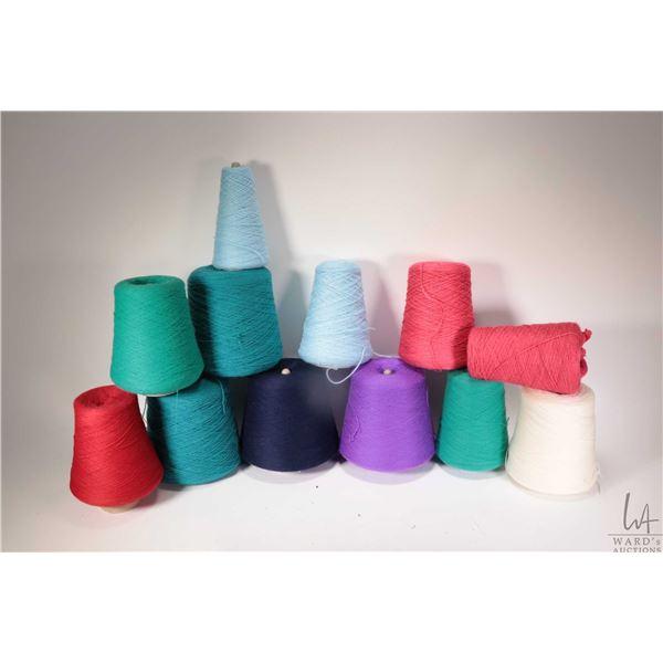 Twelve full or partial cones of knitting machine /hand knitting yarn including two full cones of Sta