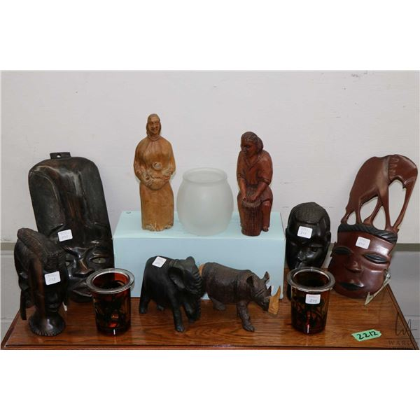 """Selection of African treenware including two masks, two 7"""" busts, a pair of fully carved figures, an"""
