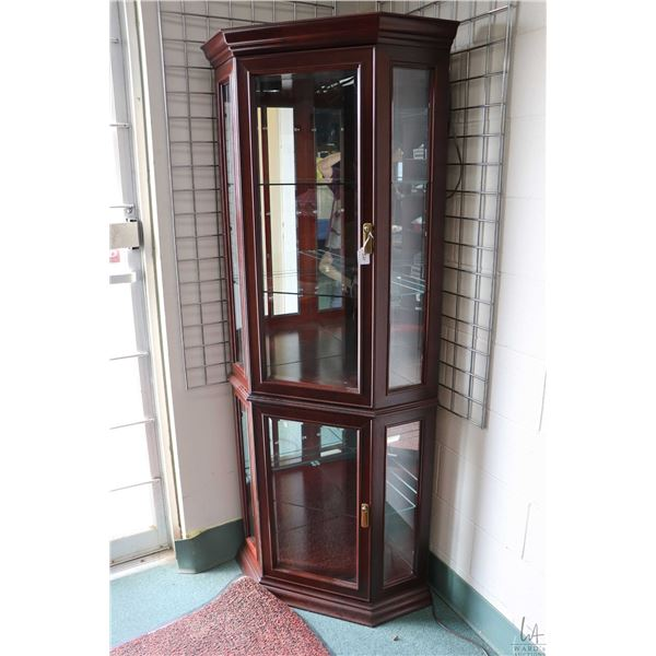 Modern three sided illuminated corner display cabinet with bevelled glass front panels and glass she