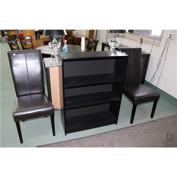 Small open bookshelf and two faux leather upholstered side chairs
