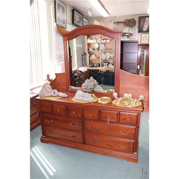 Four piece bedroom suite including seven drawer mirrored dresser, pair of three drawer side tables a