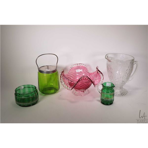 Three pieces of Victorian glass including biscuit barrel, hand enamelled and gilded cream and sugar,