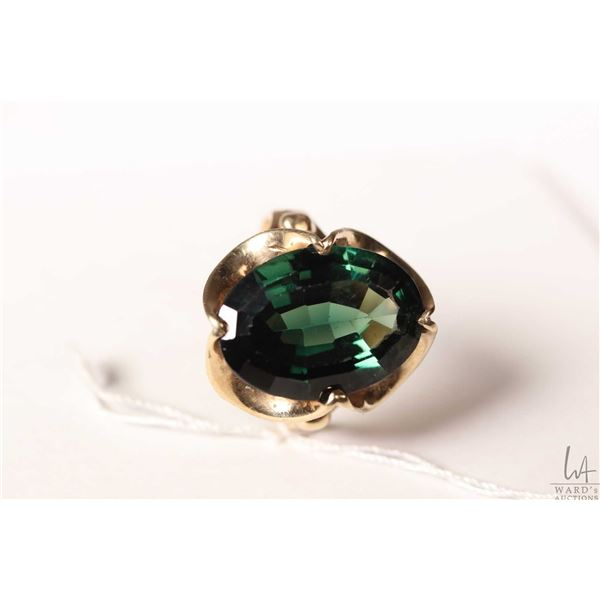 10kt yellow gold ring set with large oval green gemstone like center stone, size 9.25