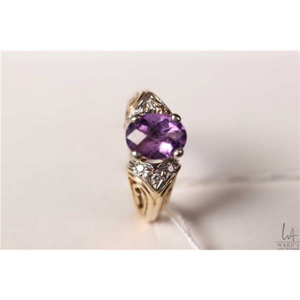 10kt yellow and white gold ring set with oval amethyst gemstone and accent diamonds