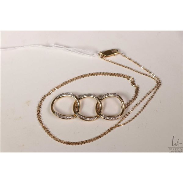 """14kt yellow gold 18"""" neck chain with triple circle gold pendant set with genuine diamonds"""