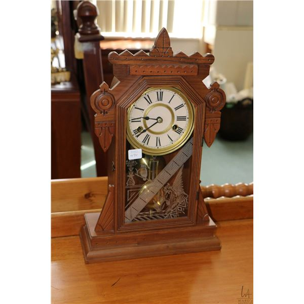 Small chiming gingerbread clock with lithographed glass depicting odd collection of gryphon, housepl