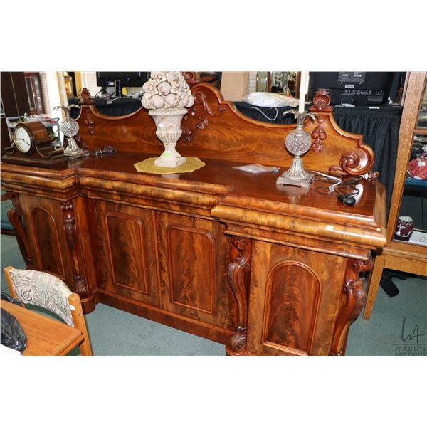 Victorian flame mahogany sideboard with carved scroll columns, raised panel doors and attached carve