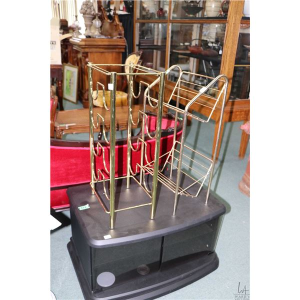 Swiveling television stand plus a faux brass book rack and wine rack