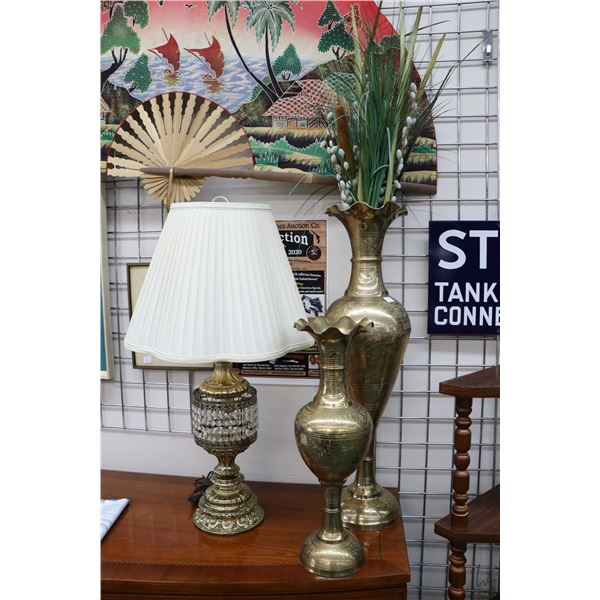 """Two hand chaised brass floral vases, 21"""" and 31"""" in height plus a brass table lamp with lustres and"""