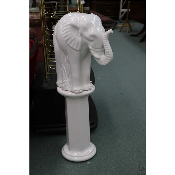"""Glazed ceramic elephant and a 19"""" high statuary stand. Note: Not Available For Shipping. Local Picku"""