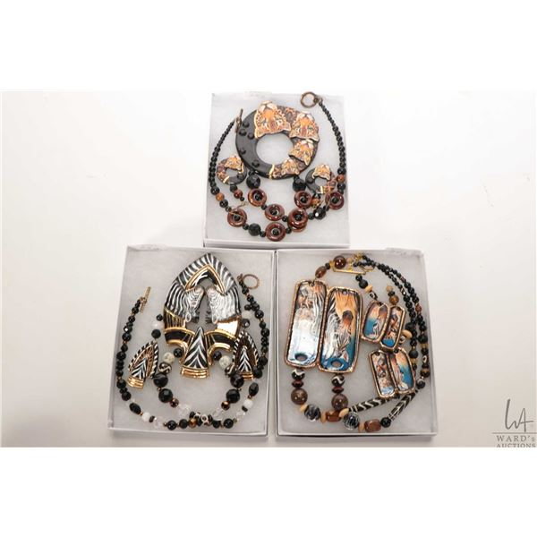 Three handmade and handpainted porcelain and beaded necklaces with matching earrings including leopa