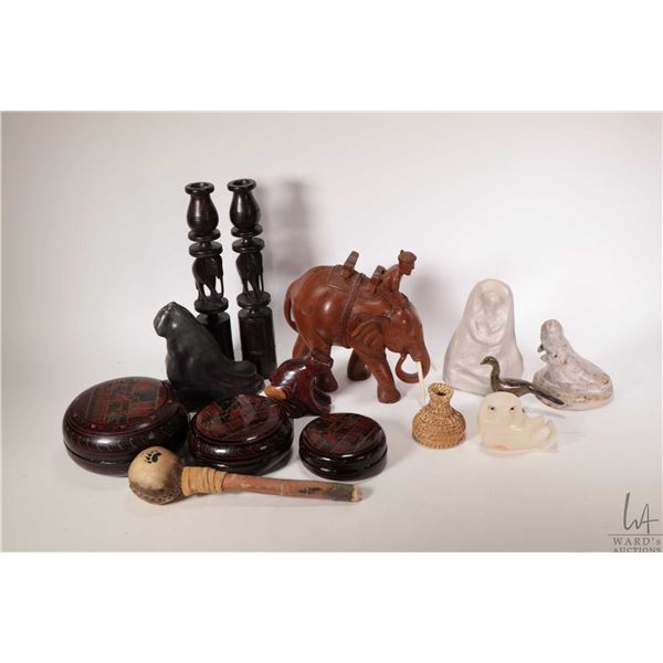 """Selection of treenware carvings including pair of 11 1/4"""" elephant motif candlestick, carved elephan"""