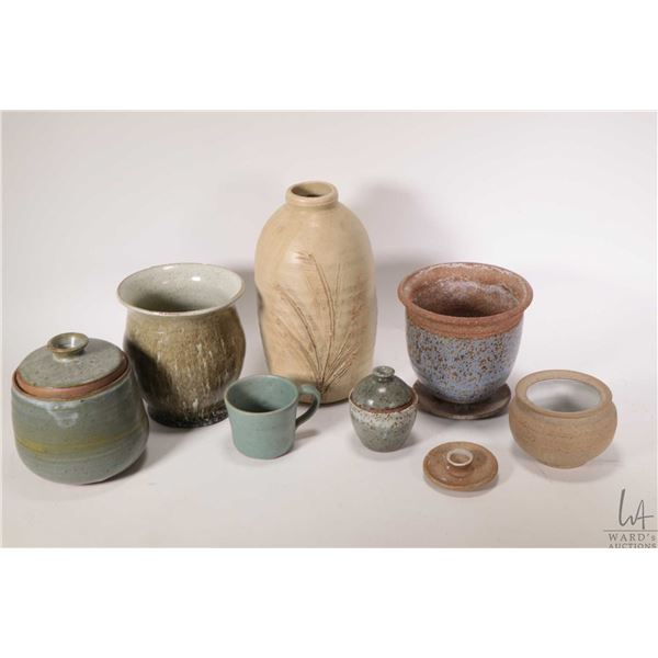"""Selection of pottery including 9 1/4"""" vase initialled by artist, three lidded pots, a glazed pottery"""