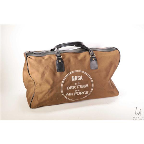 Interested black and tan tote bag labelled Nasa c.c. Dep.T.7865 U.S. Air Force