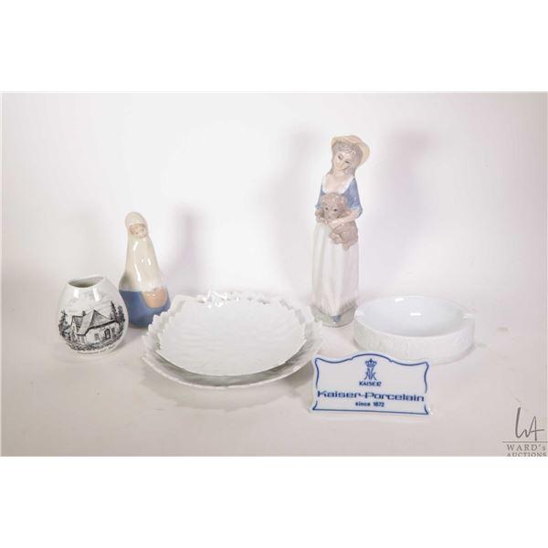 Five pieces of Kaiser Porcelain including two leaf motif plates, a bisque ashtray, cottage motif sma