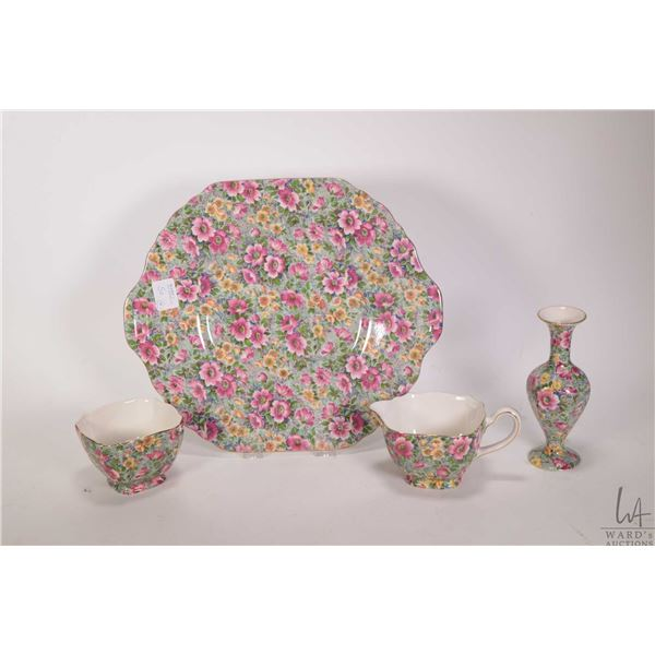 """Four pieces of Lord Nelson Ware chintz """"Briar Rose"""" including double handled cake tray, cream and su"""
