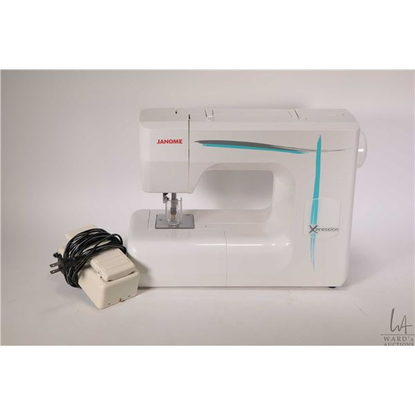 Janome Xpression felting machine with foot controller, tool kit and needles, working at time of cata