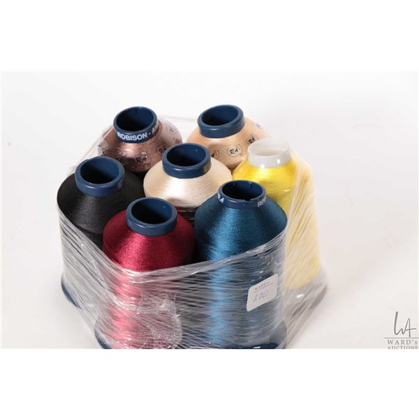 Seven spools of Robinson-Anton Textile rayon machine embroidery thread, various colours