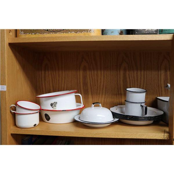 Shelf lot of vintage enamel ware including teapot, plates, pots, pans, cups, covered butter dish etc