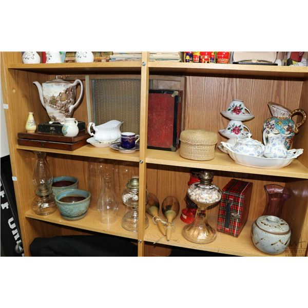 Two shelf lots of collectibles including vintage colourless oil lamps, tin lunch box, boxed silverwa