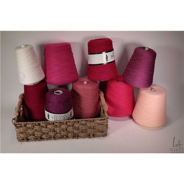Nine full and partial cones of knitting machine/ hand knitting yarn including full Barbie Pink, Newr