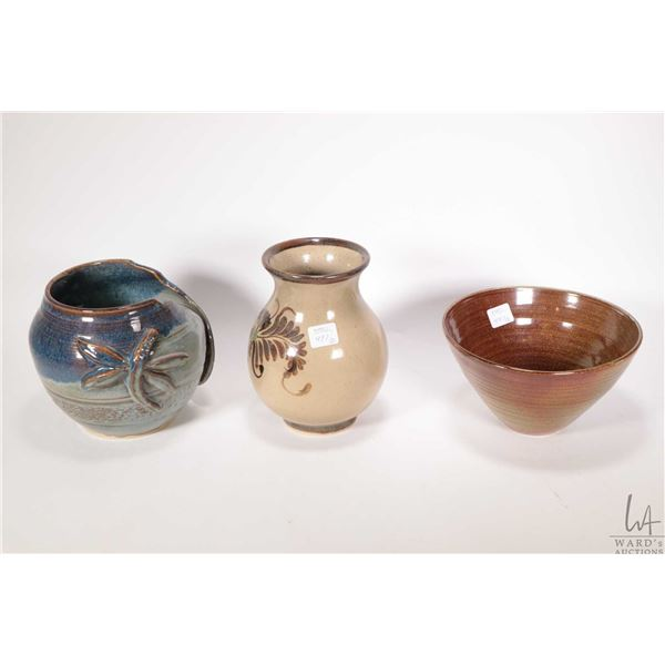 """Three art pottery vases including dragon fly motif 5 1/2"""" signed DNG, a tapered glazed vase intitial"""
