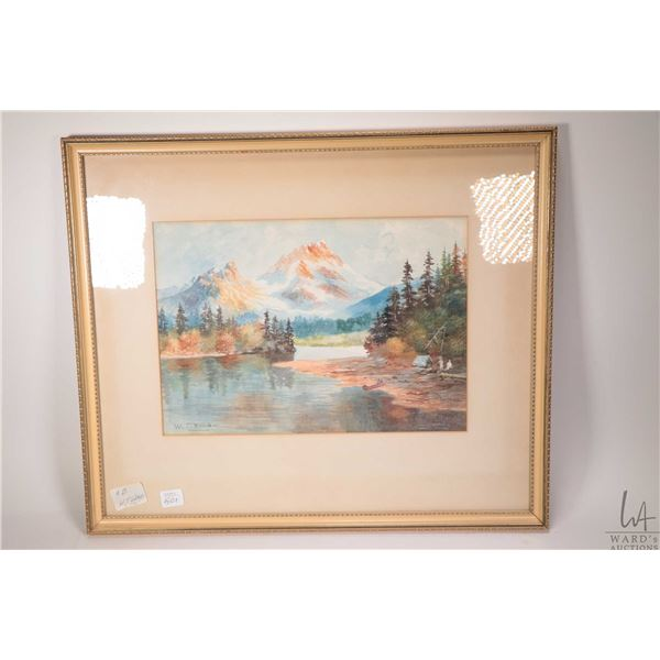Framed original watercolour painting of a shore line camp near the mountain signed by artist W.T. Wo