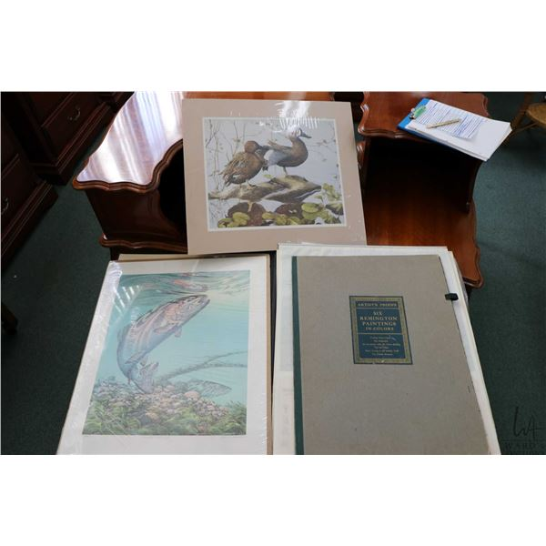 Portfolio containing six Fredric Remington prints of cowboys and Indians on horse back plus two   Wi