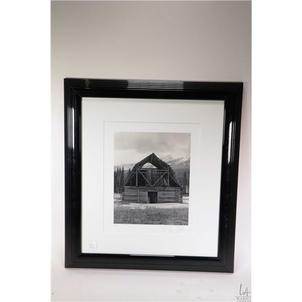 """Two framed black and white photographs including titled on verso """"Barn, British Columbia"""" by Therese"""
