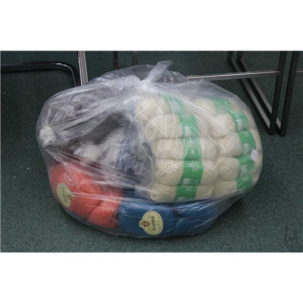 Bag containing bundles of hand knitting yarn including ten 50 gram balls of Aran pure wool, twenty 5