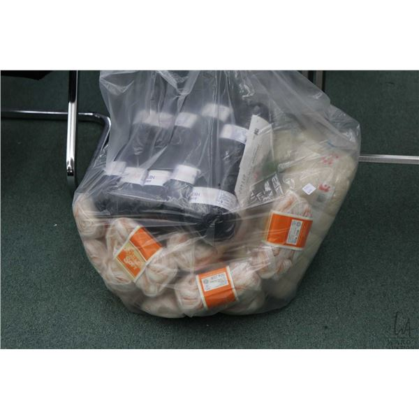 Bag containing bundles of hand knitting yarn including nine 50 gram balls of Aran pure wool, twenty