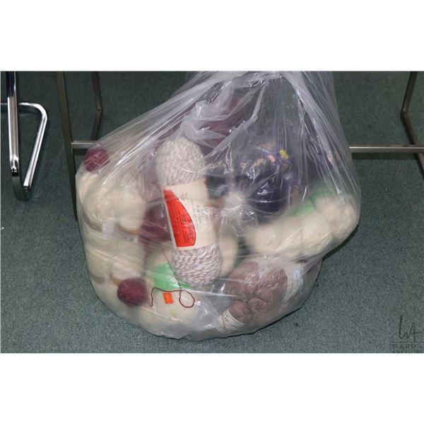 Bag containing bundles of hand knitting yarn including twenty 50 gram balls of Aran pure wool, nine
