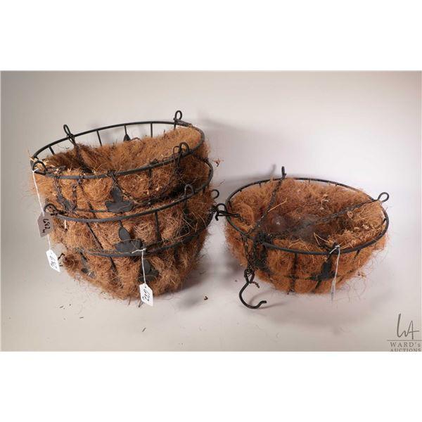 "Four round 14"" diameter Fleur-de-lis motif planters with chain hangers and coco liners"