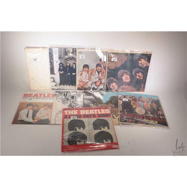 """Nine vintage Beatles LPs including """"Rubber Soul ( US pressing)"""", """"White Album ( US pressing)"""", """"Hard"""