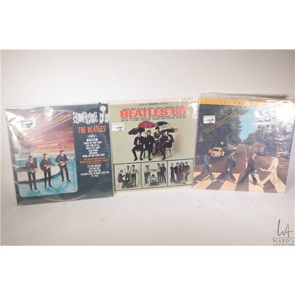 "Three vintage Beatles LPs including ""Beatles '65"" ( Canadian pressing), note $125 price tag, "" Somet"