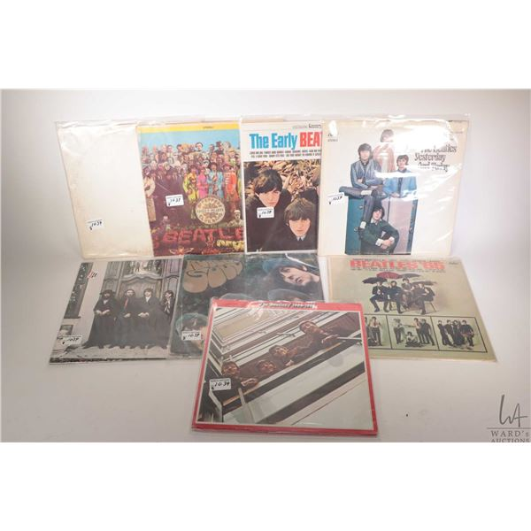 """Eight Beatles LPs including """"White Album"""" """"Sgt. Pepper's"""" (both Canadian) """"Hey Jude"""" with original C"""
