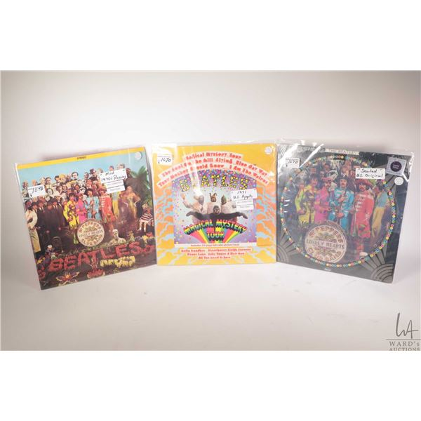 """Three Beatles LPs including """"Sgt. Peppers"""" (mid 70's Canadian pressing), """"Magical Mystery Tour"""" ( ea"""
