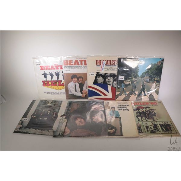 """Eight Beatles LPs including """"Abbey Road"""" (Canadian pressing), """"The Beatles' Story"""" ( Marked Red Labe"""