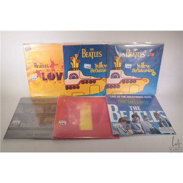 """Five Beatles LPs, all appear to be reissues including """"Let it Be....Naked"""", """"Love"""" etc."""