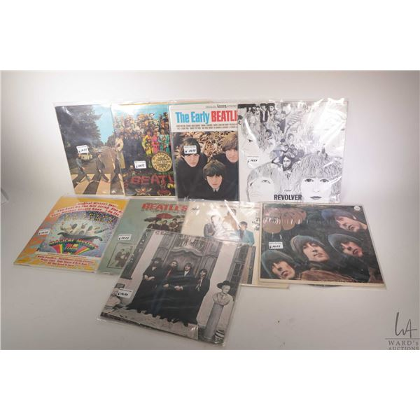 """Nine Beatles LPs including """"Revolver"""" (Canadian pressing) """"The Early Beatles"""", """"Sgt. Peppers"""" plus o"""