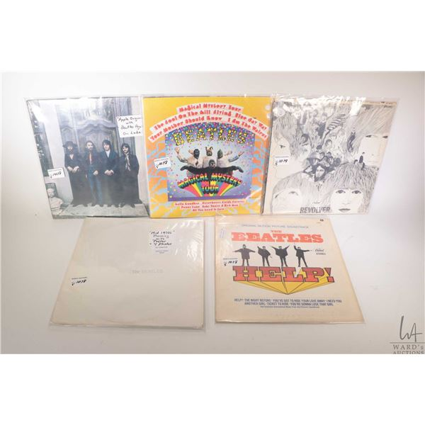 """Five Beatles LPs including ?White Album"""" (on black vinyl with posters, Canadian pressing) """"Revolver"""""""
