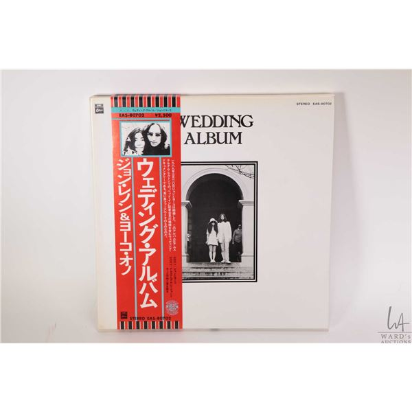 """Boxed set """"The Wedding Album"""" (made in Japan and includes LP, assorted posters etc. note has $150 re"""
