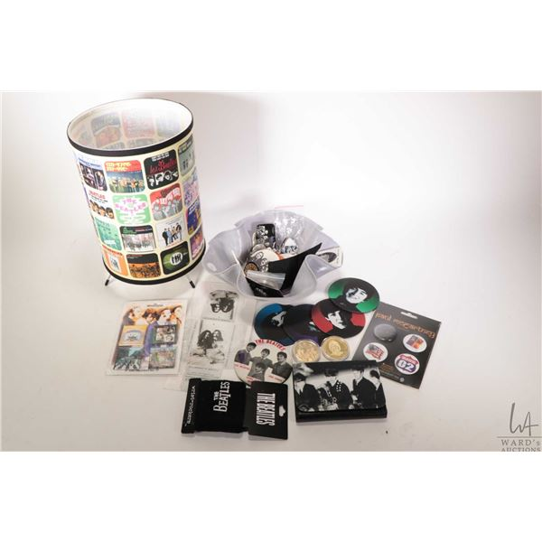Selection of Beatles collectible merchandise including coasters, ruffled LP center bowl, vintage pin