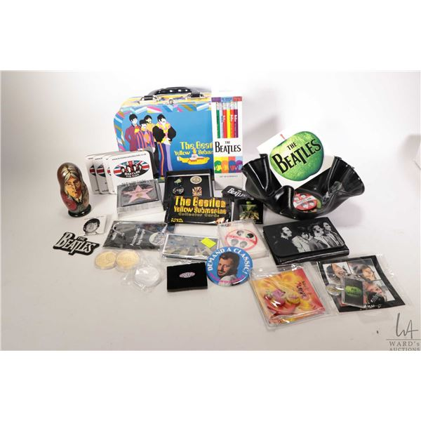 Selection of Beatle collectibles including stacking dolls, ruffled LP bowl, wallet, pin back buttons