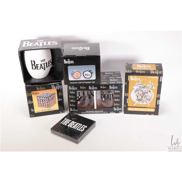 Selection of Beatles collectibles including Glasses, mug, ceramic box, salt and pepper shaker and co