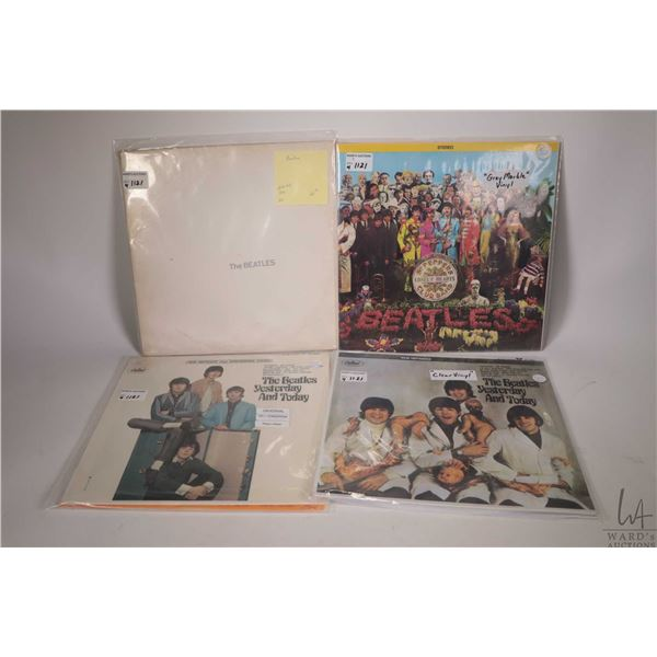 """Four Beatles albums including """"The White Album"""" (white vinyl with poster, Canadian pressing), """"Sgt."""
