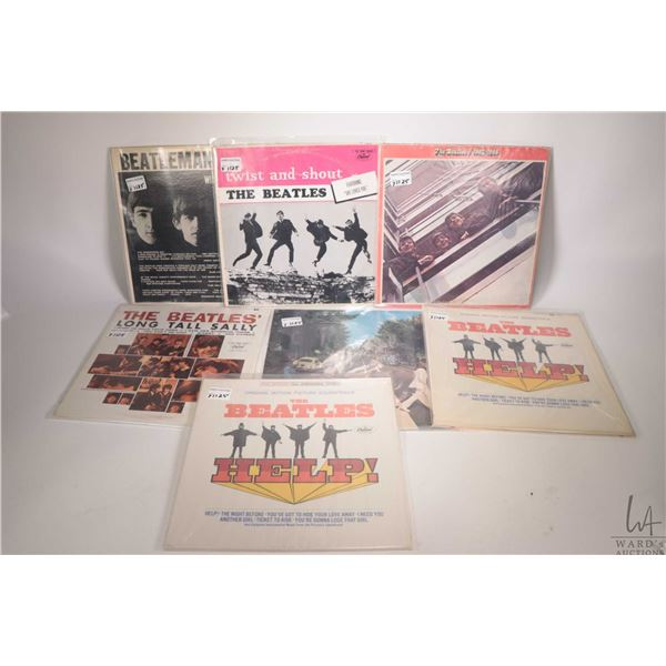 """Seven vintage Beatles LPs including """"Beatlemania"""" (Canadian), """"Twist and Shout"""" (Canadian), """"Help"""" p"""